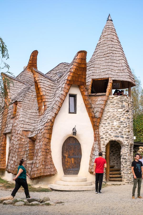 Fairytale clay castle of Porumbacu village. Porumbacu Village, Romania - 14 September 2019. people visiting Clay Castle of the Fairy Valley in Porumbacu de Sus stock image