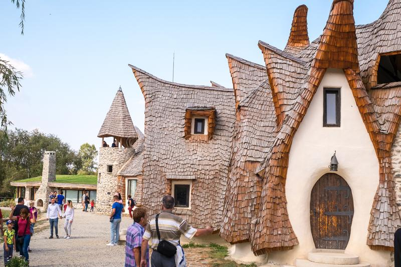 Fairytale clay castle of Porumbacu village. Porumbacu Village, Romania - 14 September 2019. people visiting Clay Castle of the Fairy Valley in Porumbacu de Sus stock photo
