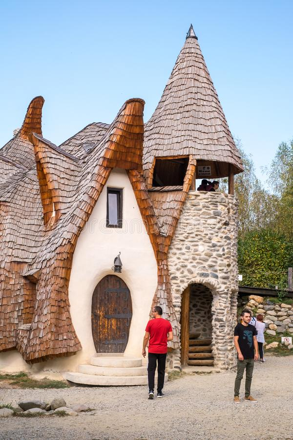Fairytale clay castle of Porumbacu village. Porumbacu Village, Romania - 14 September 2019. people visiting Clay Castle of the Fairy Valley in Porumbacu de Sus stock photos