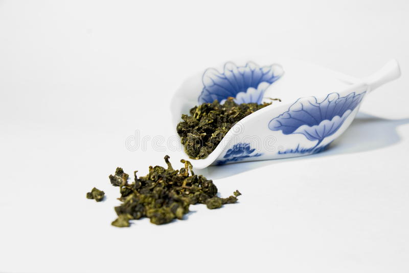 Porzellanschüssel mit grünem Tee lizenzfreie stockbilder