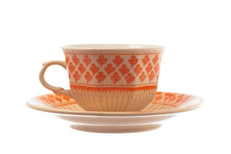 Porzellanweinlesetee- oder -kaffeetasse und untertasse lokalisiert auf Weiß lizenzfreie stockbilder
