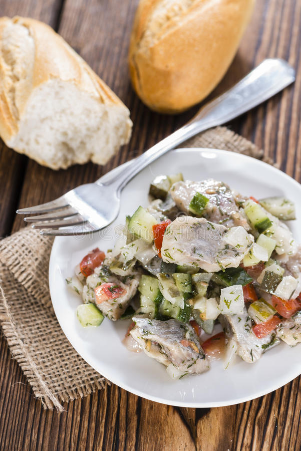 Porzione di insalata di aringa fotografie stock