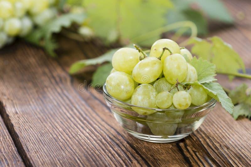 Porzione di uva verde fresca fotografia stock