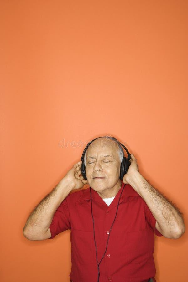 posłuchaj słuchawki zdjęcia royalty free
