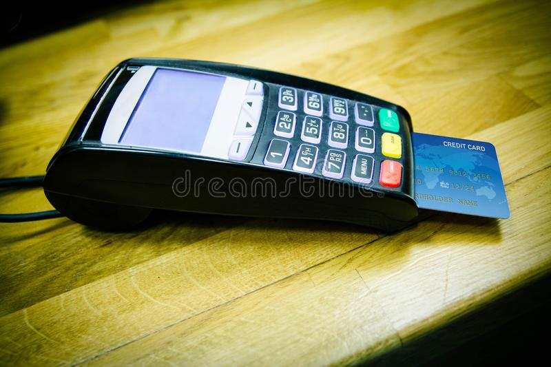 POS and credit card. Payment machine on during using Credit card stock photos