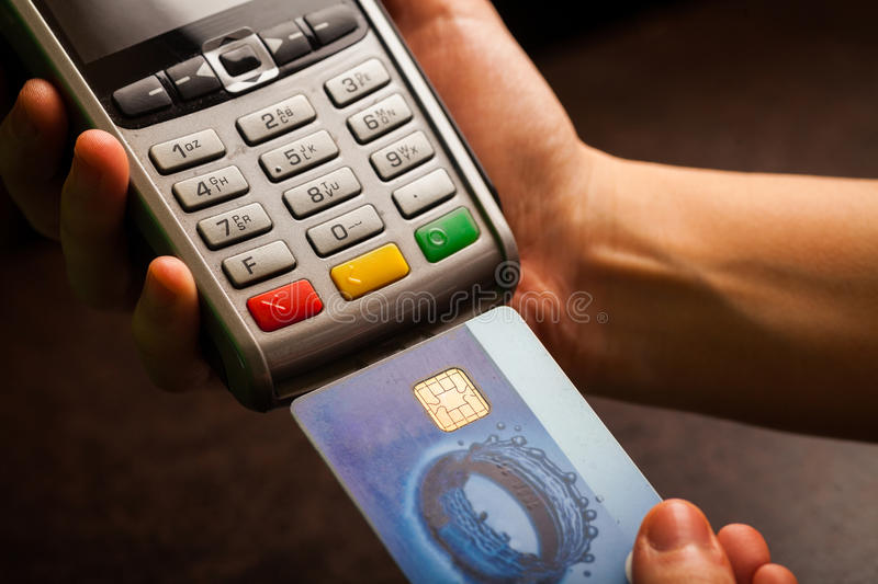 POS and credit cards. Color image of a POS and credit cards stock photography