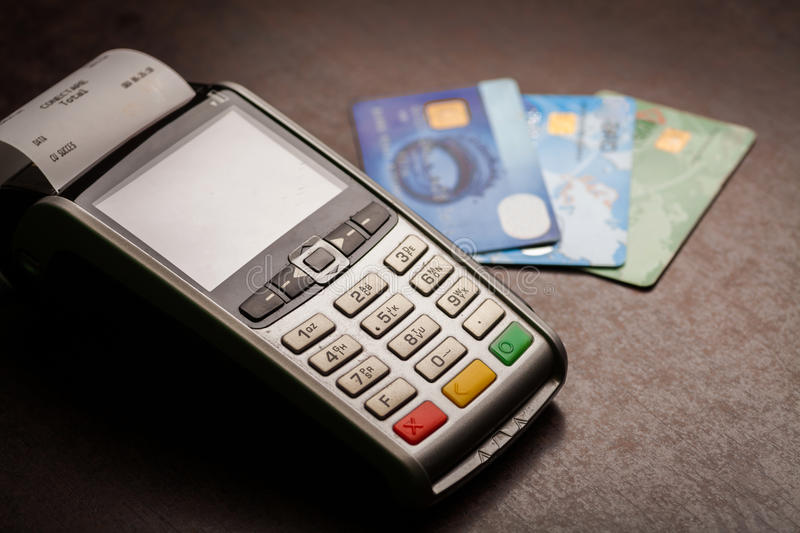 POS and credit cards. Color image of a POS and credit cards royalty free stock image