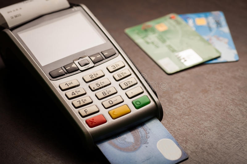 POS and credit cards. Color image of a POS and credit cards royalty free stock photos