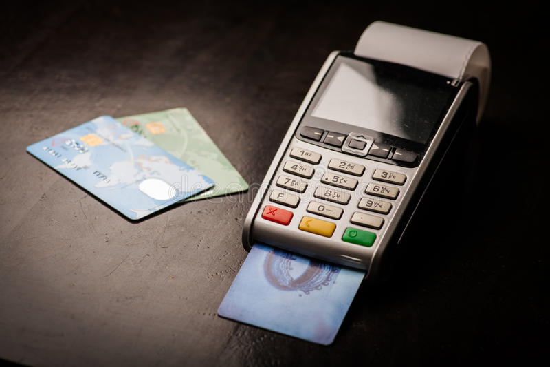 POS and credit cards. Color image of a POS and credit cards royalty free stock images