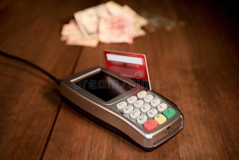 POS terminal vs money royalty free stock photo