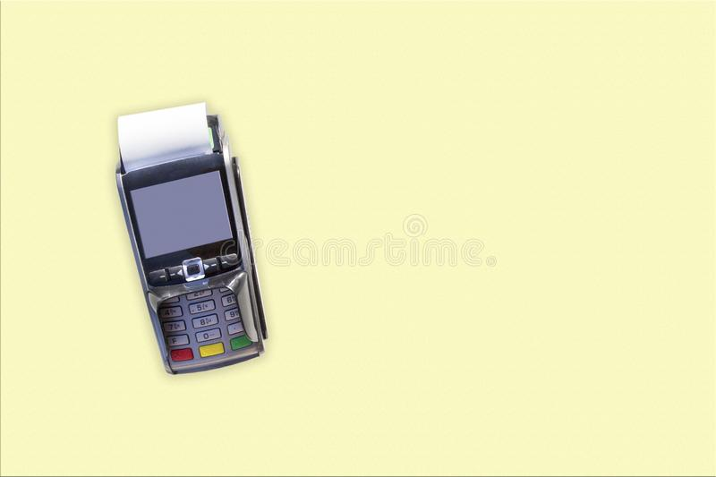 POS terminals, hand swiping credit card, payment with NFC tecnology isolated on light yellow background.  royalty free stock image