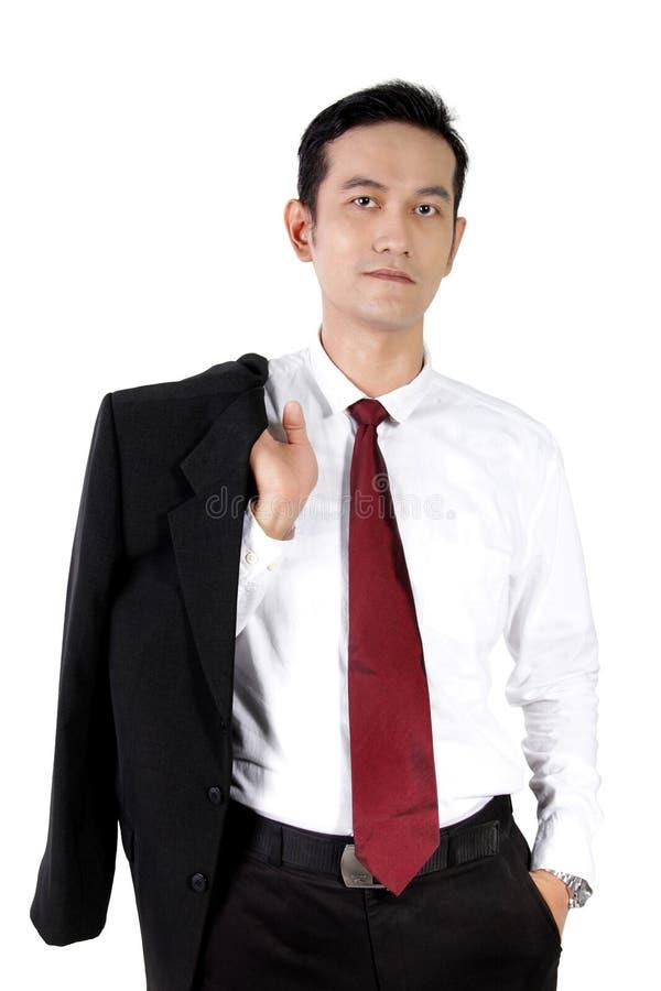 Posa casuale di giovane uomo d'affari asiatico, isolata su bianco fotografie stock