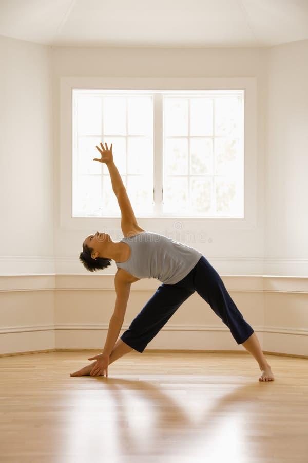 Posa Del Triangolo Di Yoga Fotografia Stock