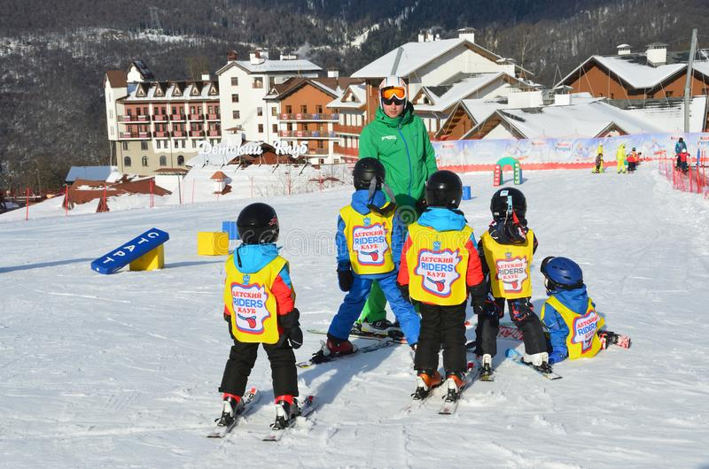 Posa Khutor, Sochi, Russia, January, 26, 2018. Lesson in the children`s ski club `Riders` in the ski resort Rosa Khutor. Posa Khutor, Sochi, Russia. Lesson in royalty free stock images