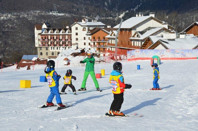 Posa Khutor, Sochi, Russia, January, 26, 2018. Lesson in the children`s ski club `Riders` in the ski resort Rosa Khutor. Posa Khutor, Sochi, Russia. Lesson in stock images