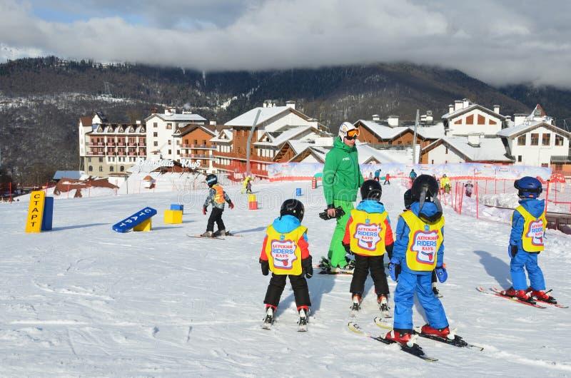 Posa Khutor, Sochi, Russia, January, 26, 2018. Lesson in the children`s ski club `Riders` in the ski resort Rosa Khutor. Posa Khutor, Sochi, Russia. Lesson in royalty free stock image