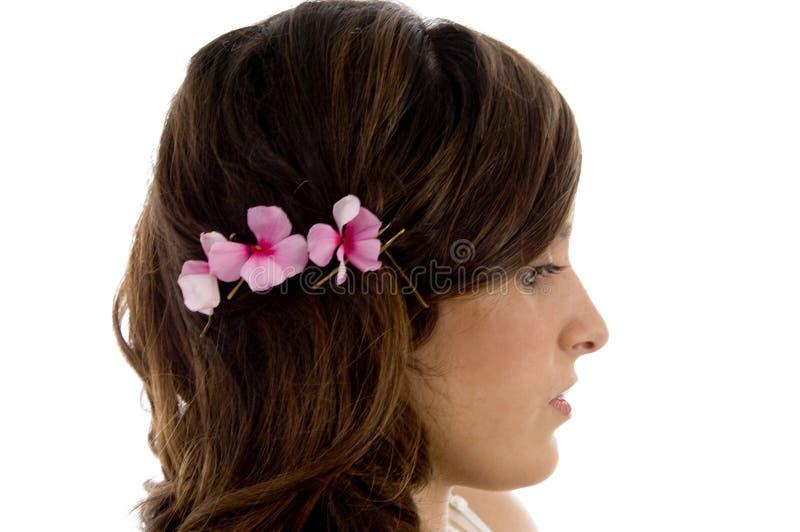Posa laterale di capelli femminili fotografie stock libere da diritti