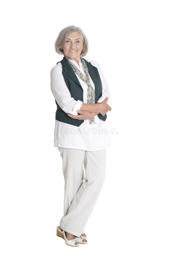 Posa senior integrale e seria della donna, isolata fotografia stock