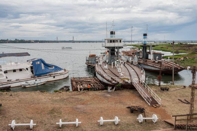 Posadas Argentina. The shore of Parana river with boats and the bridge. Posadas, Argentina stock image
