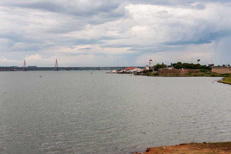 Posadas Argentina. The shore of Parana river with a lighthouse and the bridge. Posadas, Argentina stock photos
