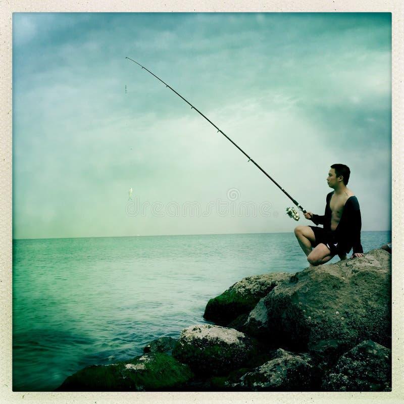 Posando con una canna da pesca immagini stock