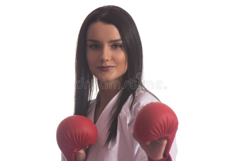 Pose de combattant du Taekwondo de portrait d'isolement sur le fond blanc image libre de droits