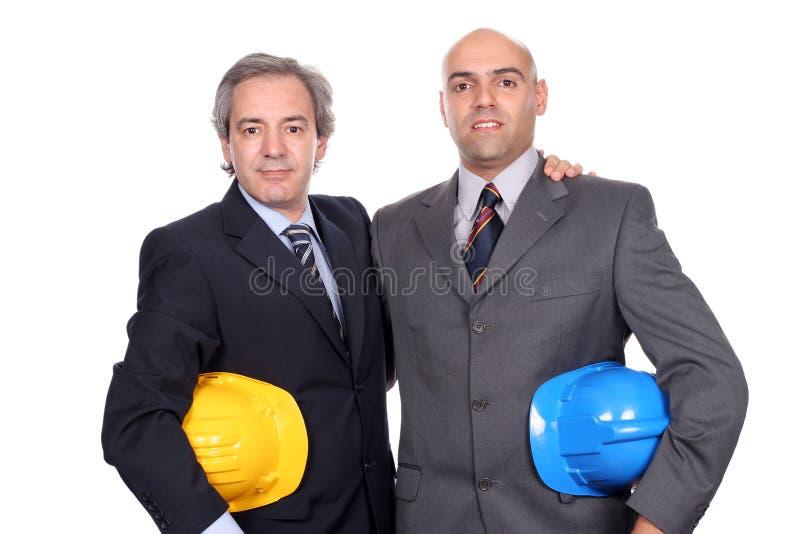 Pose de deux jeune hommes d'affaires images libres de droits