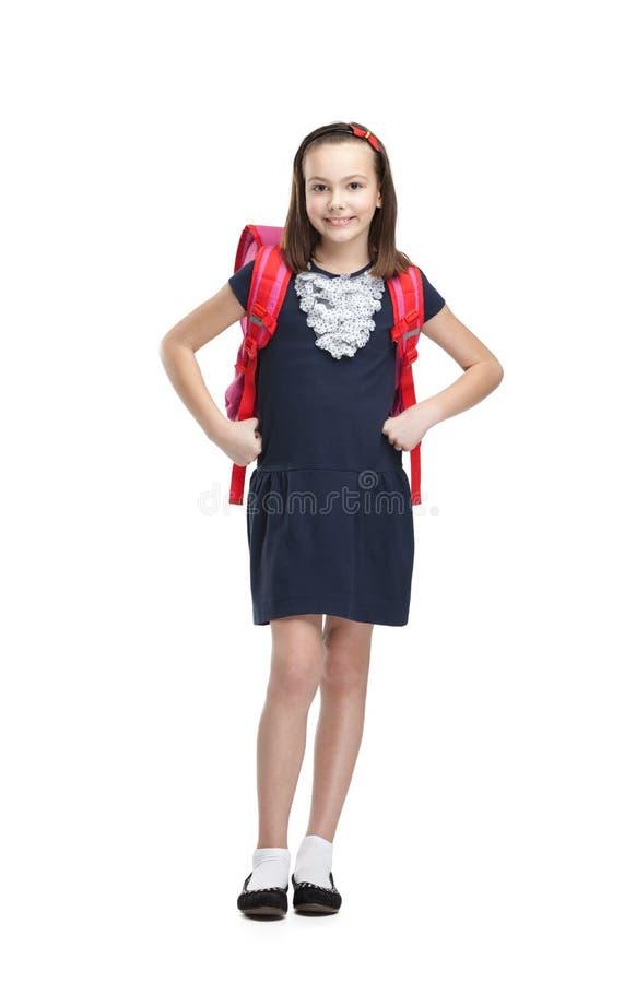 Pose de l'écolière avec la serviette photo stock