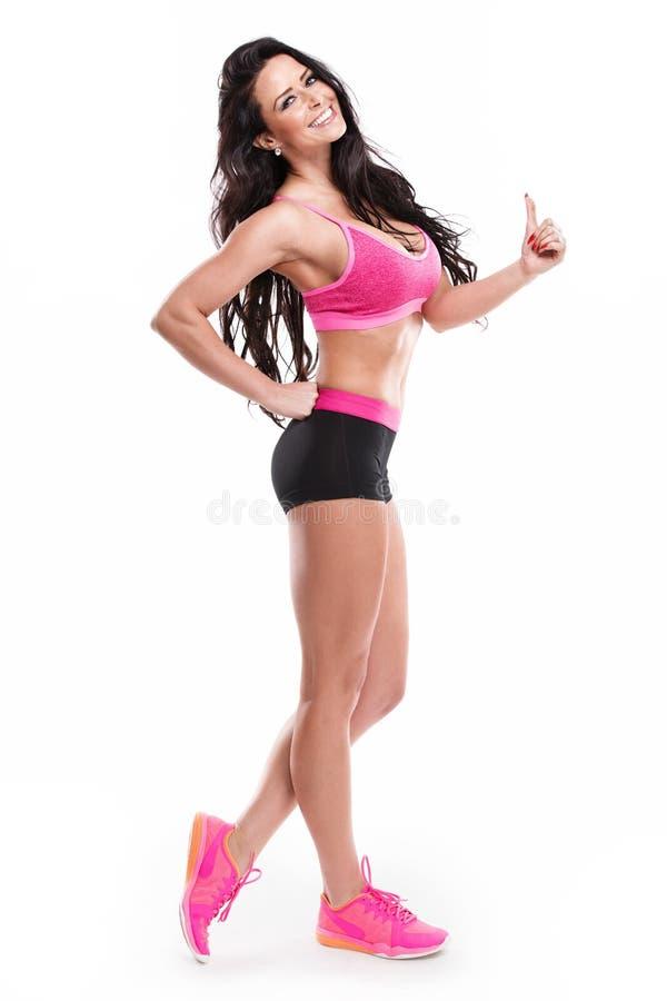 Pose de la femme sexy de belle forme physique photographie stock