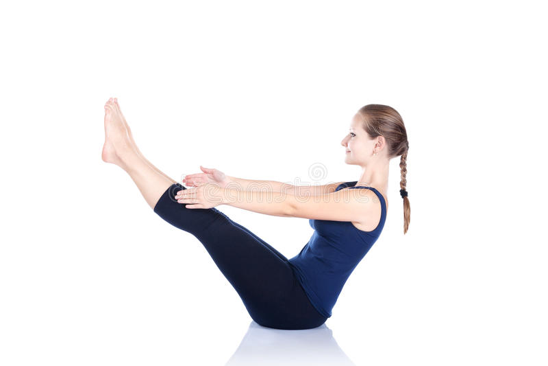 Pose de navasana de paripurna de yoga photo libre de droits