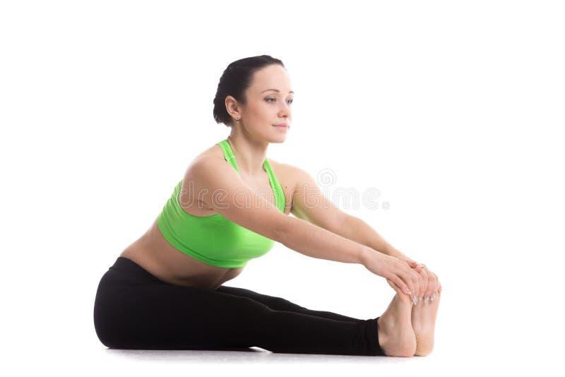 Pose dorsale intense de yoga de bout droit photos stock