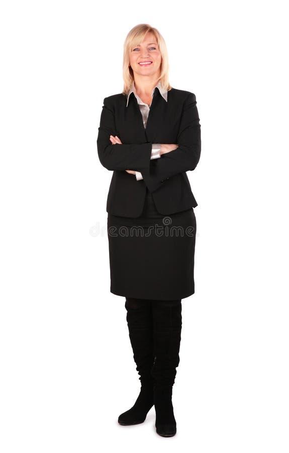 Pose entre deux âges de femme d'affaires images stock