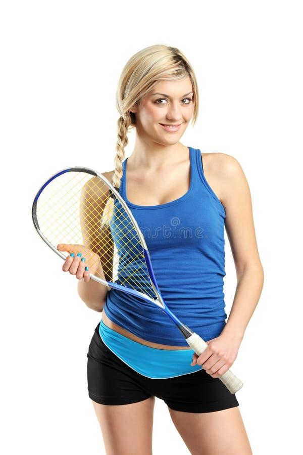 Pose femelle de sourire de joueur de courge image stock
