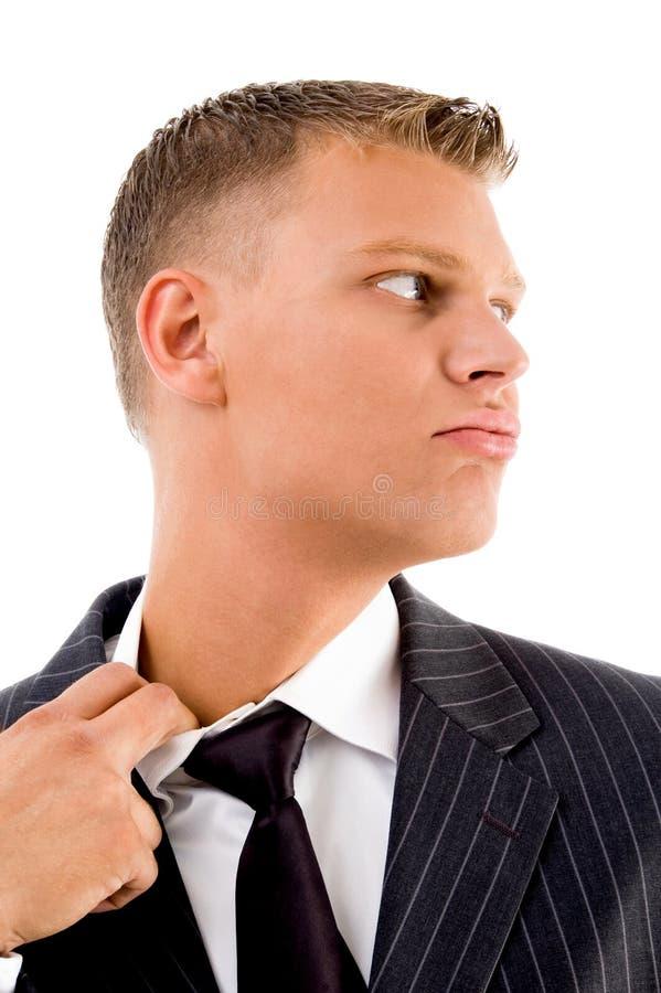 Pose lateral do sentimento do homem de negócios quente fotografia de stock royalty free