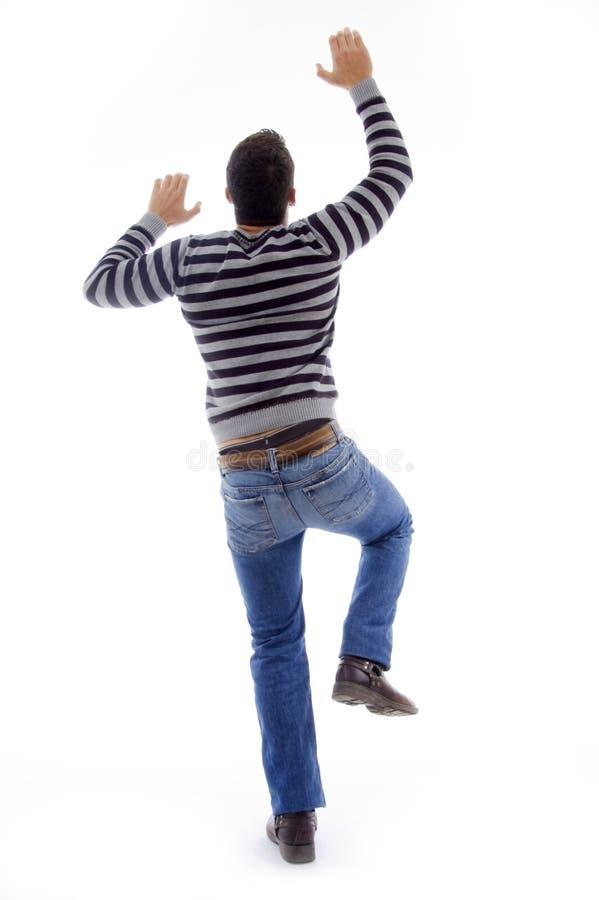 pose s'élevante arrière d'homme de danse images libres de droits