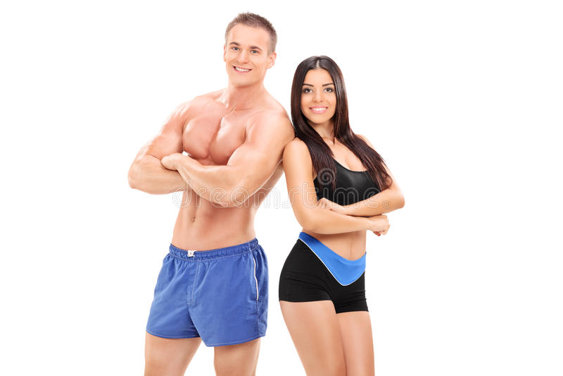 Pose sexy d'athlètes masculins et féminins images libres de droits