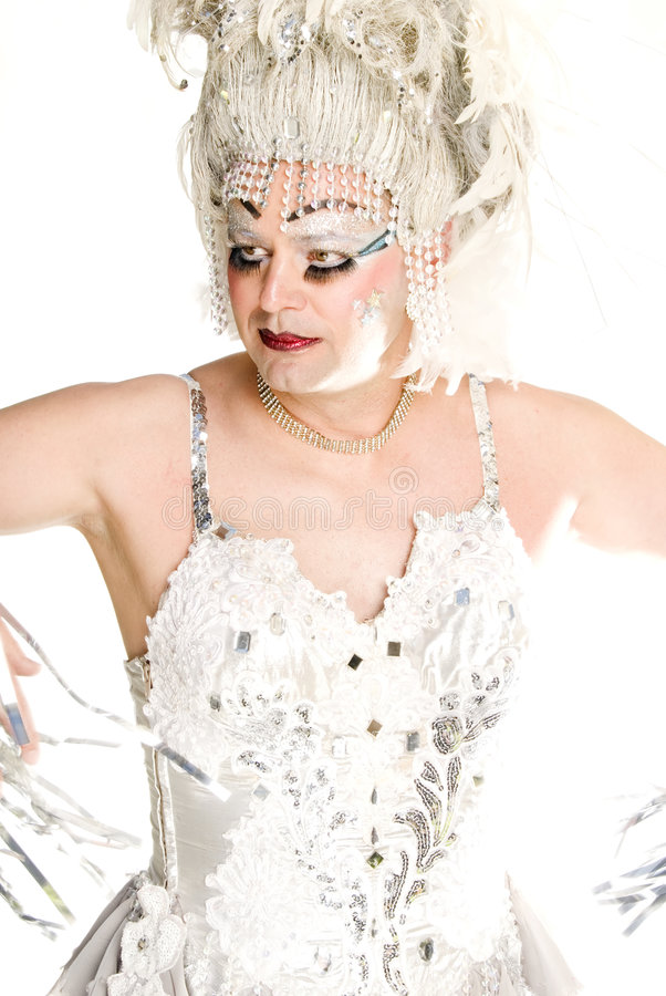 Posed Drag Queen. This image shows a drag queen dressed in a silver outfit stock photo