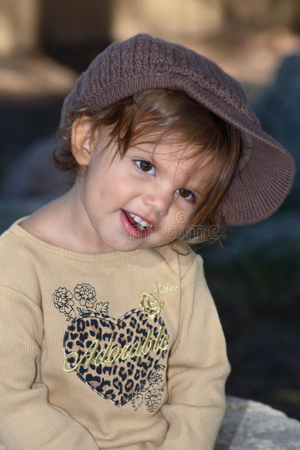Posed Savanah. A portrait of a little girl posed in a cut looking face stock photography