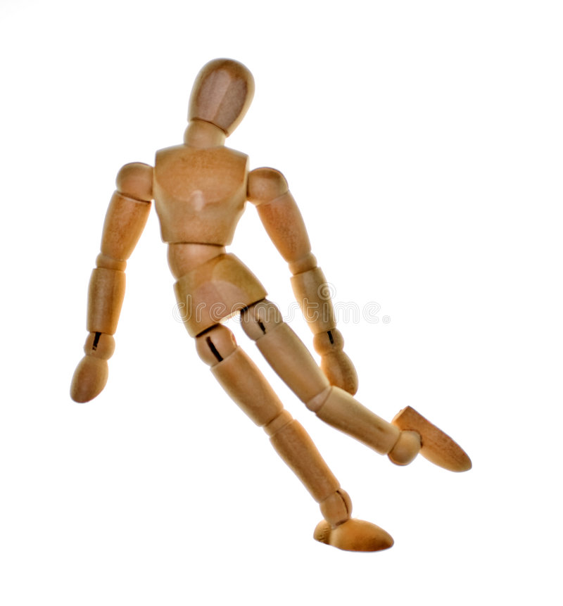 Posed Wooden Mannequin. One posed wooden mannequin on white background. Lit from behind to elliminate shadows royalty free stock photos