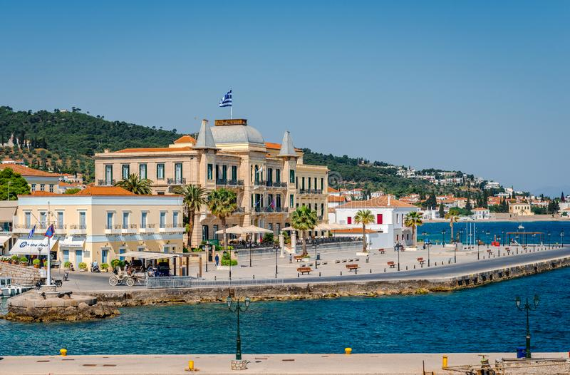 The Poseidonion Grand Hotel, in the port of Spetses, Greece. Spetses / Greece - April 28 2018: View of the port, with the Poseidonion Grand Hotel, one of the royalty free stock images