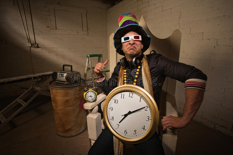 Poser in Large Hat and Clock. Pouting rapper in throne with large hat and clock stock photos