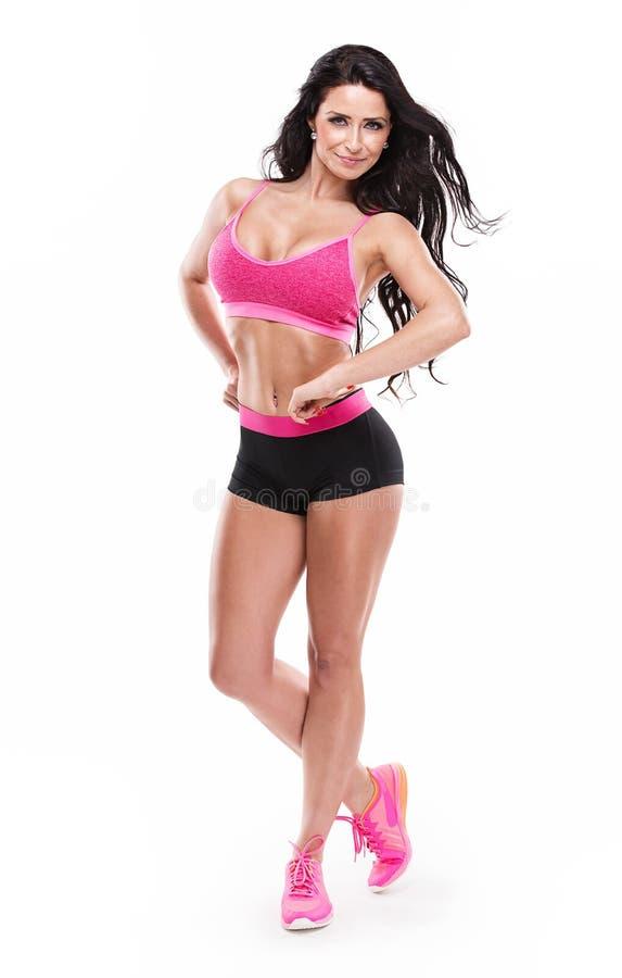 Posera den sexiga kvinnan för härlig kondition arkivfoton
