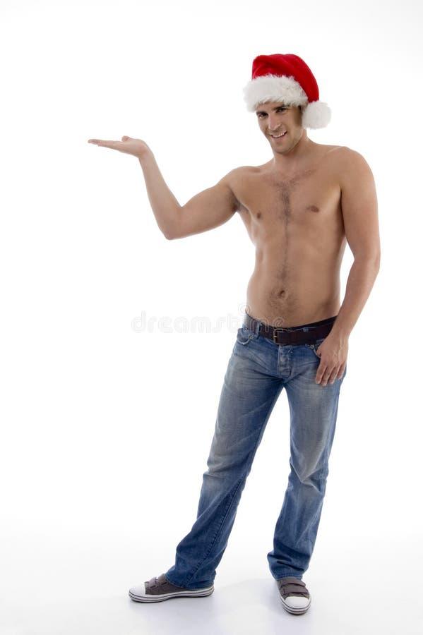 posera för modell för julhatt som male är shirtless royaltyfri bild