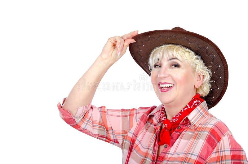 Poses de sorriso da vaqueira no fundo branco imagens de stock