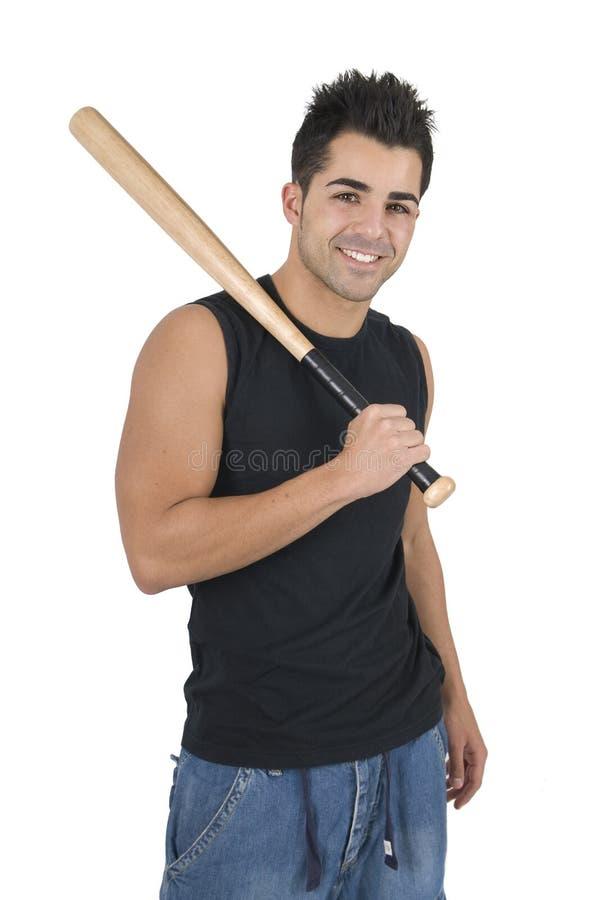 Poses masculinos novos do jogador de beisebol com bastão fotos de stock royalty free