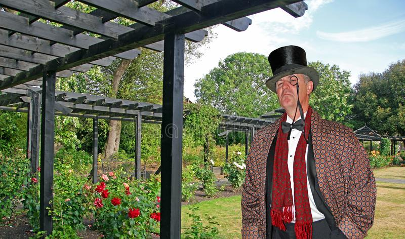 Posh country gent in garden royalty free stock photos