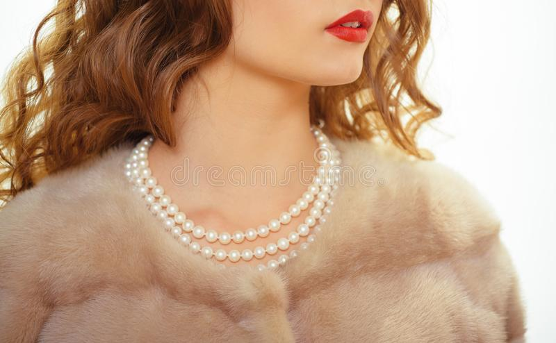 For posh girl. Pearl necklace and mink fur. Natural pearl beads and fur. Fashion accessory and jewelry. Classic retro. Style design. Vintage pearl jewelry royalty free stock photos