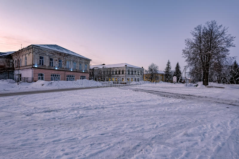 Poshekhonie small town, Yaroslavl region, Russia. Marketplace in Poshekhonie small town, Yaroslavl region, Russia at early very cold winter morning stock image