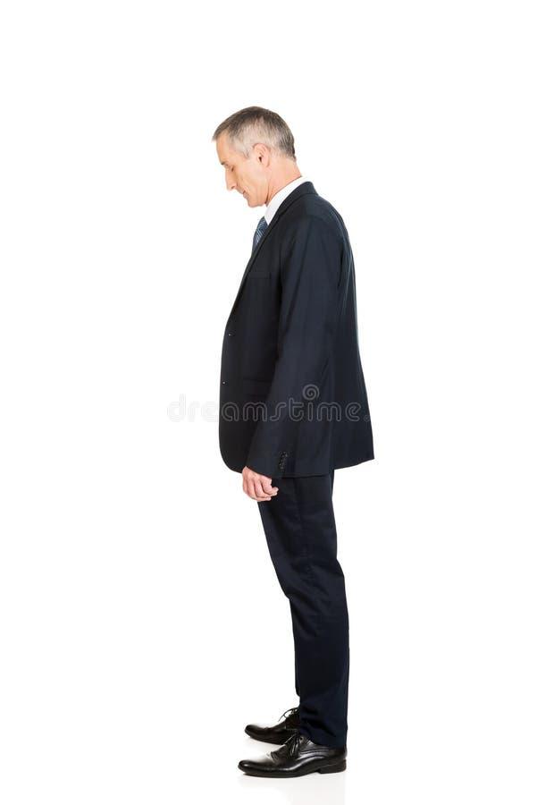 Posição completa do homem de negócios da opinião lateral do comprimento imagens de stock