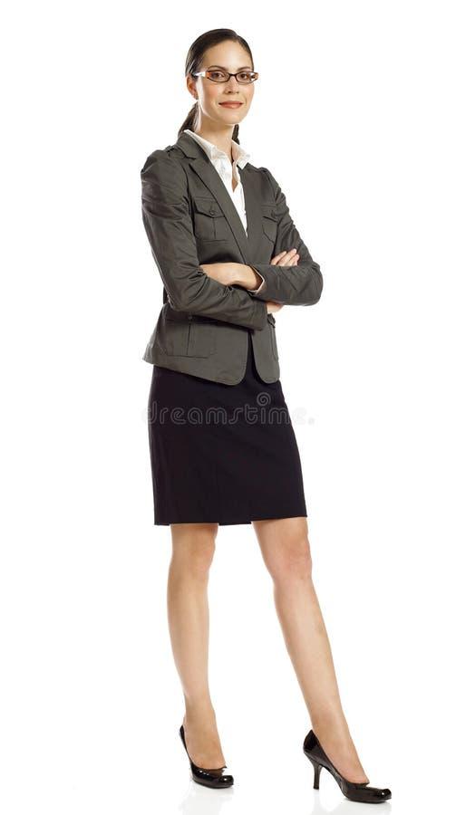Posição confiável da mulher de negócios fotografia de stock royalty free
